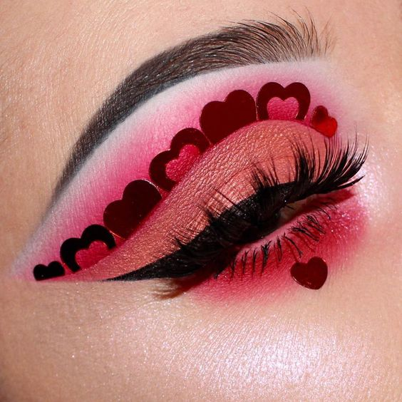 Pink eyeshadow look with hearts in the crease.