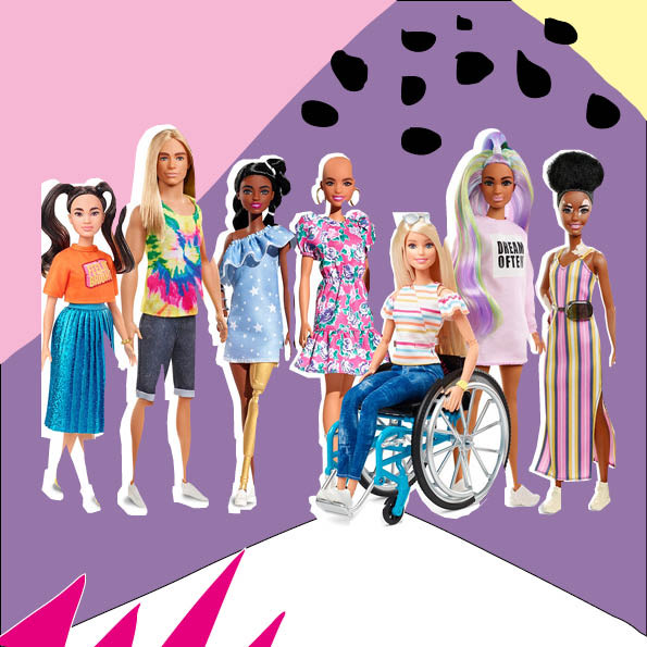 Inclusive barbie dolls stood in a line