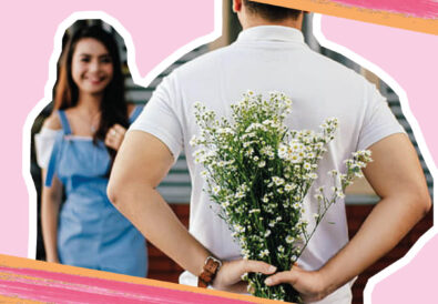 man holding flowers behind his back ready to surprise girlfriend