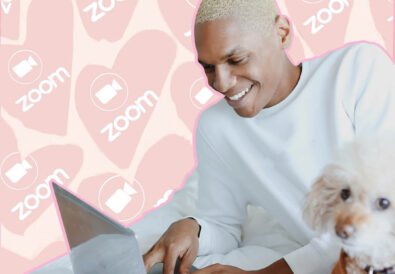 Man on his laptop smiling. The background behind him is pink with hearts that say Zoom.
